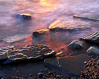 Rocks along Lake Superior at sunset. Porcupine Mountains Wilderness State Park Michigan