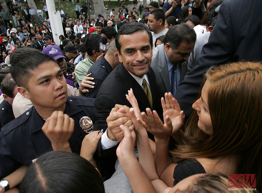 Los Angeles Mayor Antonio Villaraigosa, center, arrives at City Hall,Monday, March 27, 2006, to talk with protesting students, after they walked out of class. Students walked out of school today to protest against proposed federal immigration reforms, many walking several miles to reach Los Angeles City Hall.