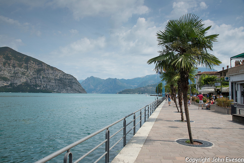 Promenade at Iseo, Lake Iseo or Lago d'Iseo or Sebino is the fourth largest lake in Lombardy, Italy, fed by the Oglio river. It is in the north of the country in the Val Camonica area, near the cities of Brescia and Bergamo.