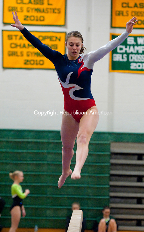 NEW MILFORD, CT 05 FEBRUARY 2013- --020713JS02--ACTION MAN- Nonnewaug's Jenna Rinaldi competes on the beam during SWC Gymnastics Championships Thursday at New Milford High School. Rinaldi won the All-Around during the event. .Jim Shannon Republican American .