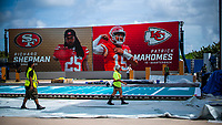 MIAMI, USA - January 24: Workers setup the Super Bowl XLIV fan zone on January 24, 2020 in Miami Beach, USA.  The Super Bowl XLIV will take place in the Hard Rock Stadium in Miami between the teams 49ers vs. Chiefs, and it will be played on Sunday, Feb. 2, 2020. (Photo by VIEWpress)