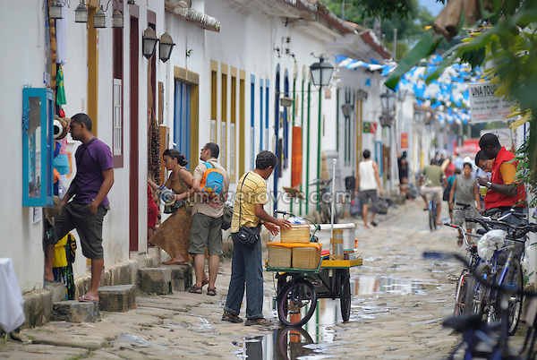 Local brazilian man selling goods of his mobile shop in the historic center; Paraty, Espirito Santo, Brazil. --- Info: The beautiful colonial town of Paraty has been a UNESCO World Heritage Site since 1958. --- No signed releases available.