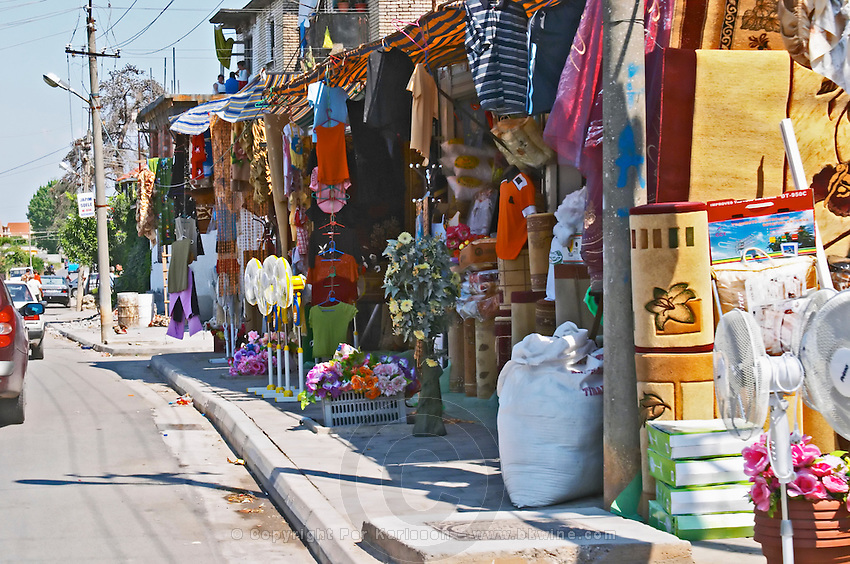 Street scene in Koplik near Shkodra with street market with market stalls selling all sorts of household goods. Albania, Balkan, Europe.