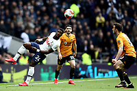 1st March 2020; Tottenham Hotspur Stadium, London, England; English Premier League Football, Tottenham Hotspur versus Wolverhampton Wanderers; Serge Aurier of Tottenham Hotspur flicks the ball towards Diogo Jota of Wolverhampton Wanderers