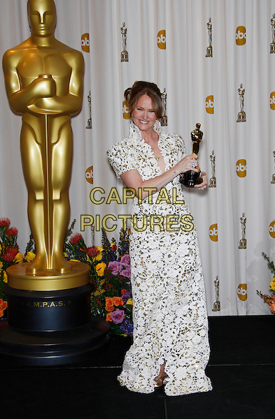 MELISSA LEO.Best Actress in a Supporting Role.83rd Annual Academy Awards - Oscars.Kodak Theatre, Hollywood, CA, USA..February 27th, 2011 .Pressroom press room winner trophy full length shoulder pads dress long maxi white lace high collar  .CAP/PE.©Peter Eden/Capital Pictures.