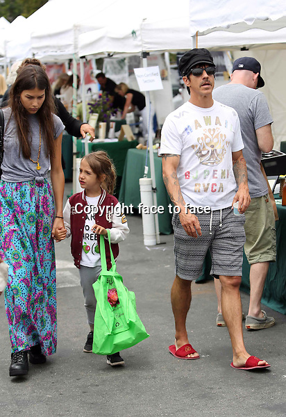 What the heck is he wearing? Hotel slippers??? Anthony Kiedis went shopping on a local farmers market with his much younger girlfriend, Helena Vestergaard, and his son, Everley Bear. Los Angeles, California on June 23, 2013<br /> Credit: Vida/face to face