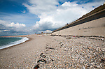 Shingle beach and large sea wall providing coastal defence at Chiswell, Isle of Portland, Dorset, England, UK