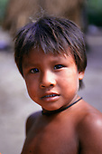 Koatinemo village, Brazil. Asurini Indian boy.