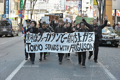 On Saturday December 6, 2014, some one hundred people in Tokyo showed their solidarity with protesters against police brutality in the USA.