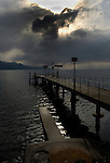 Pier under stormy clouds on ake Léman, Vevay, close to Montreux,Lausanne, Switzerland.