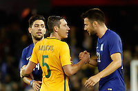June 7, 2016: MARK MILLIGAN (5) of Australia and ANDREAS SAMARIS (22) of Greece shake hands after an international friendly match between the Australian Socceroos and Greece at Etihad Stadium, Melbourne. Photo Sydney Low