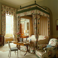 The grand master bedroom is a vision of chintz, with curtains, bed hangings and armchair all dressed in the same floral fabric
