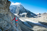 Crossing the Pas de Chèvre cables and ladders while on the Via Valais, a multi-day trail running tour connecting Verbier with Zermatt, Switzerland.