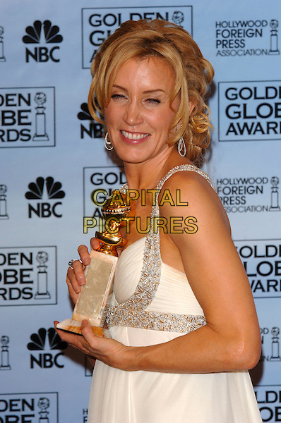 FELICITY HUFFMAN.63rd Annual Golden Globe Awards .held at the Beverly Hills Hilton, .Beverly Hills, Califronia, USA, .January 16th 2006..half length globes press room holding award winner.Ref: PL.www.capitalpictures.com.sales@capitalpictures.com.©Phil Loftus/Capital Pictures