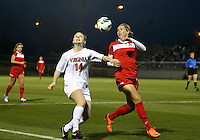 BOYDS, MARYLAND - April 06, 2013:  Stephanie Ochs (22) of The Washington Spirit battles for the ball with Kristen McNabb (14) of the University of Virginia women's soccer team in a NWSL (National Women's Soccer League) pre season exhibition game at Maryland Soccerplex in Boyds, Maryland on April 06. Virginia won 6-3.