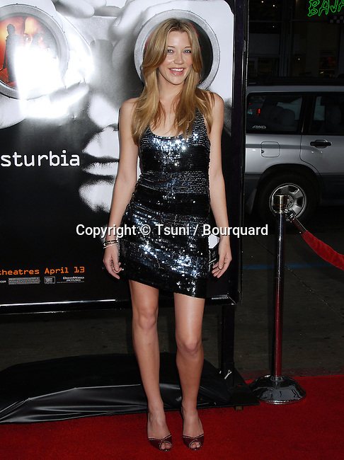 Sarah Roemer  arriving at the DISTURBIA Premiere at the Chinese Theatre in Los Angeles.<br /> <br /> full length<br /> eye contact<br /> smile