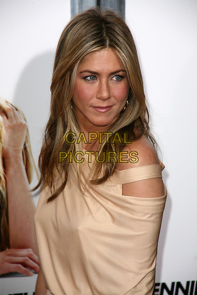 JENNIFER ANISTON.At the New York City film premiere of 'The Bounty Hunter' at Ziegfeld Theatre in New York City, NY, USA, .March 16, 2010 .arrivals portrait headshot  make-up beige gold cut out off the shoulder nude side looking over shoulder side .CAP/ADM/PZ.©Paul Zimmerman/Admedia/Capital Pictures
