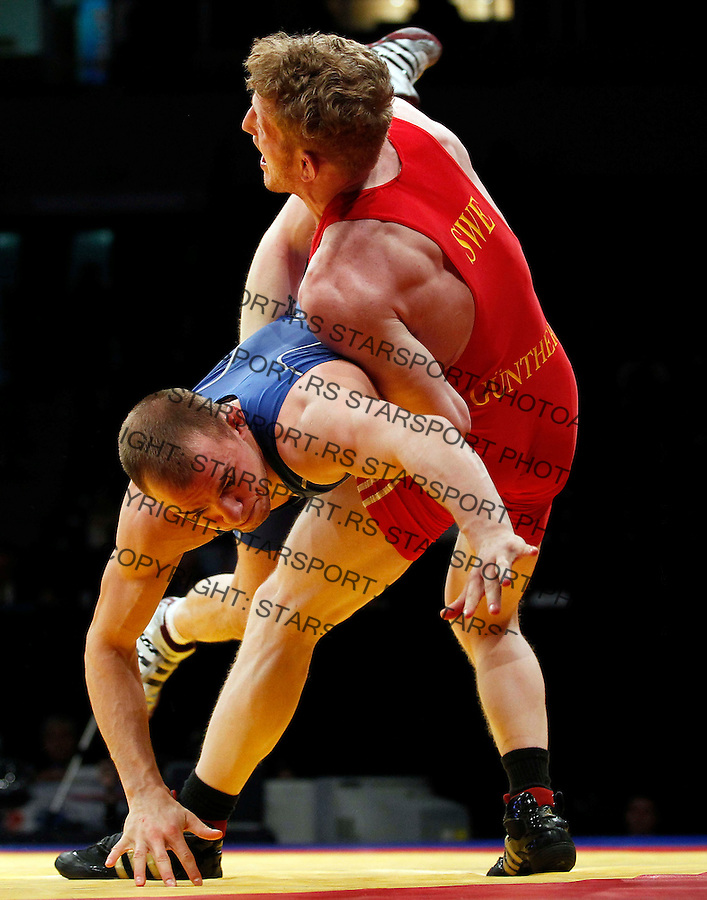 BELGRADE, SERBIA - MARCH 11: Aleksandar Maksimovic of Serbia (L) fights with Ove Mathias Gunther of Sweden (R) during bronze medal Men's Greco-Roman style 66kg match at the European wrestling championship March 11, 2011 in Belgrade, Serbia.(Photo by Srdjan Stevanovic/Getty Images)