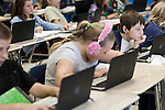 November 15, 2011. Mooresville, NC.. Calvin Warner, right, a 5th grader at East Mooresville Intermediate School, works on an in class science lesson on his school issued laptop.. The Mooresville school system has become nationally known for being on the cutting edge of using technology as an educational tool. Starting in 3rd grade, each student is issued their own laptop that they will use in class and at home to further their learning.