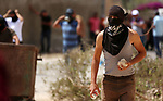 A Palestinian protester hurls stones towards Israeli forces during clashes following a weekly demonstration against the expropriation of Palestinian land by Israel in the village of Kfar Qaddum, near the West Bank city of Nablus on September 7, 2018. Photo by Shadi Jarar'ah