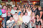 21ST: Elaine Costello, Douglas, Killorglin (seated centre) celebrates her 21st birthday with her friends and family in Bunkers Bar, Killorglin, last Saturday night..