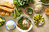 VIETNAM, Saigon, restaurant Pho Hoa aka Pho Hoa Pasteur, a shot of chicken pho in a bowl, dressed with scallions and fresh green herbs atop, and many side dishes, Ho Chi Minh City