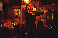 Musicians perform a traditional tango at Bar Sur, a venerable tango club in central Buenos Aires.