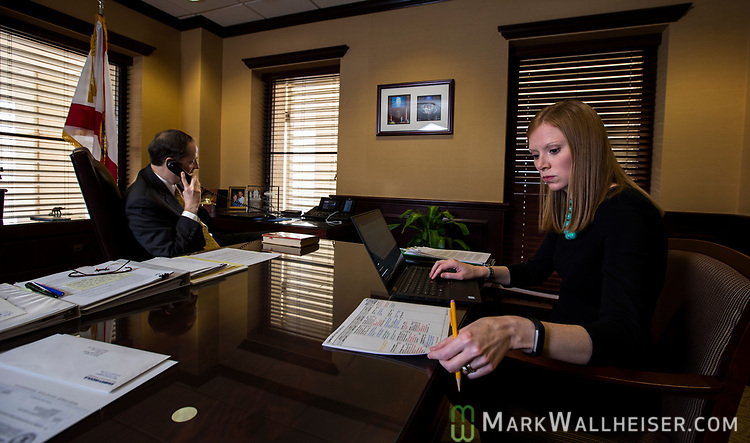 Katherine Betta, Deputy Chief of Staff on Communications for Senate President Joe Negron in Negron's office taking notes during a phone call at the Florida Capitol in Tallahassee Florida March 14, 2017.