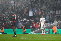 Jefferson Lerma of AFC Bournemouth and Jonny of Wolverhampton Wanderers get caught by the sprinklers as they came on 2 mins before the final whistle during AFC Bournemouth vs Wolverhampton Wanderers, Premier League Football at the Vitality Stadium on 23rd February 2019