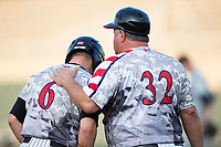 Kannapolis Intimidators interim manager Tommy Thompson (32) gives instructions to Luis Gonzalez (6) after he reached third base during the game against the West Virginia Power at Kannapolis Intimidators Stadium on July 21, 2017 in Kannapolis, North Carolina.  (Brian Westerholt/Four Seam Images)