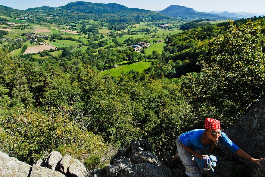 A woman hikes in the Massif Central near Le Puy-en-Velay, France.