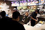 Staff of the new Taco Bell branch take orders from the press members during the pre-opening event for the restaurant's first Japanese store located in Tokyo's Shibuya district, on April 20, 2015, Japan. The store includes Japan specific dishes like shrimp and avocado burrito and taco rice on its menu. It will open to the public on April 21st. The American Tex-Mex fast food restaurant has signed a franchise agreement with Asrapport Dining Co., Ltd. to operate Taco Bell branches in Japan. (Photo by Rodrigo Reyes Marin/AFLO)