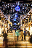 ITALY, Venice. Christmas decorations hangs over the steps leading up to the Rialto Bridge, the Puente Rialto.
