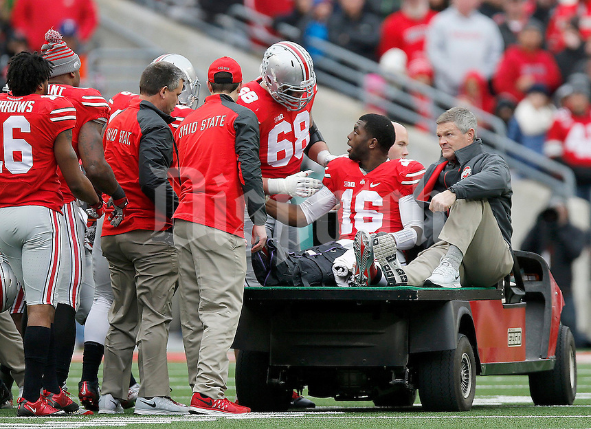 Ohio State Buckeyes quarterback J.T. Barrett (16) gets on a cart following his injury during the fourth quarter of the NCAA football game against Michigan at Ohio Stadium on Saturday, November 29, 2014. (Columbus Dispatch photo by Jonathan Quilter)