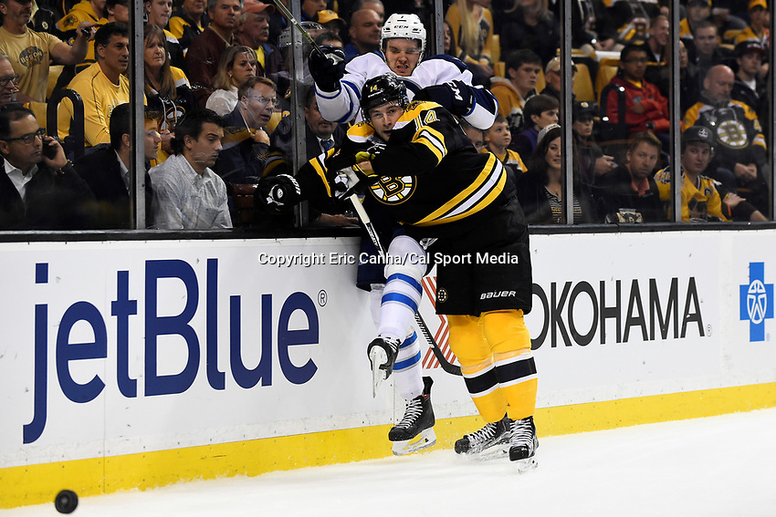 Thursday, October 8, 2015: Winnipeg Jets defenseman Ben Chiarot (7) is checked by Boston Bruins right wing Brett Connolly (14) during the NHL game between the Winnipeg Jets and the Boston Bruins held at TD Garden, in Boston, Massachusetts. Winnipeg defeated Boston 6-2 in regulation time. Eric Canha/CSM