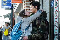 Nederland, Amsterdam, 13 maart 2016<br /> Liefde. Jong stelletje heeft een amoureus momentje op straat. <br /> <br /> Foto (c) Michiel Wijnbergh