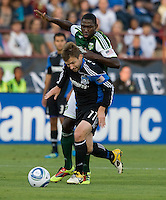 Bobby Convey of Earthquakes controls the ball away from James Marcelin of Timbers during the game at Buck Shaw Stadium in Santa Clara, California on August 6th, 2011.   San Jose Earthquakes and Portland Timbers tied 1-1.