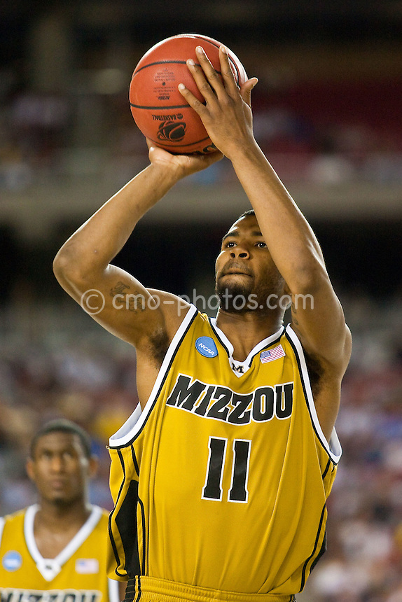 Mar 26, 2009; Glendale, AZ, USA; Missouri Tigers guard Zaire Taylor (11) shoots a free-throw in the first half of a game against the Memphis Tigers during the semifinals of the west region of the 2009 NCAA basketball tournament at University of Phoenix Stadium.    Missouri defeated Memphis 102-91.