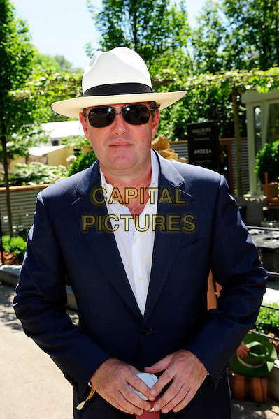 PIERS MORGAN .The Chelsea Flower Show - Press & VIP Day at Royal Hospital Chelsea. .London, England, UK, 24th May 2010..half length navy jacket shirt white sunglasses white hat fedora blue aviators .CAP/CJ.©Chris Joseph/Capital Pictures.