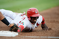 Springfield Cardinals right fielder Jose Adolis Garcia (47) dives back to first base during a game against the Corpus Christi Hooks on May 31, 2017 at Hammons Field in Springfield, Missouri.  Springfield defeated Corpus Christi 5-4.  (Mike Janes/Four Seam Images)