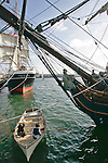 Port of San Diego, Historic Ships, San Diego, California, HMS Rose, the ship used in the film: Master and Commander (named HMS Surprise in the movie) bow, figurehead in foreground, Clipper ship Star of India in background,