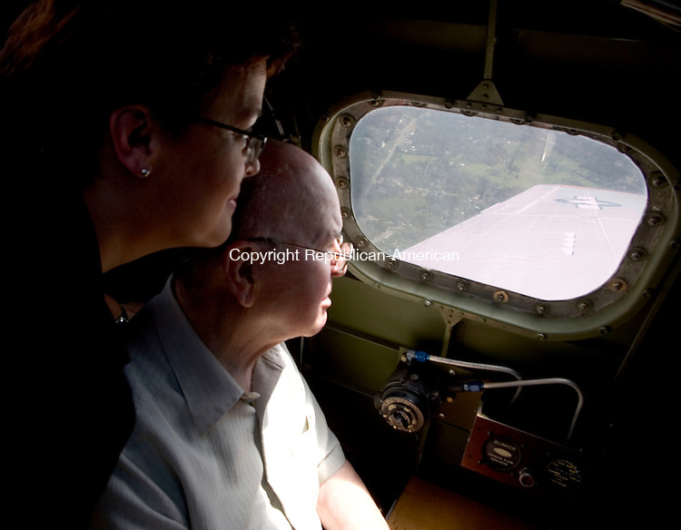 TORRINGTON, CT- 18 AUGUST 2008- 081808JT03-<br /> World War II U.S. Army veteran Remo Tiso, 83, of Southbury, looks out of a window with his daughter Phyllis Martin during a flight on a fully restored Aluminum Overcast B-17 bomber out of Waterbury-Oxford Airport in Oxford on Monday. Tiso transported prisoners of war in B-17 bombers when he served as a military policeman during the war.<br /> Josalee Thrift / Republican-American