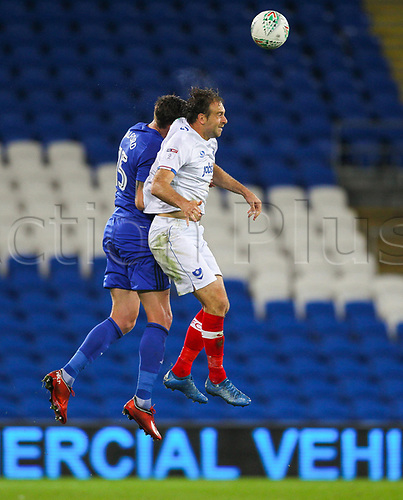 August 8th 2017, Cardiff City Stadium, Cardiff, Wales; Carabao Cup First Round; Cardiff City versus Portsmouth; Greg Halford of Cardiff City and Brett Pitman of Portsmouth challenge for the ball during the match