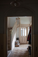 A quiet backstair in the servants quarters has carved banisters painted blue