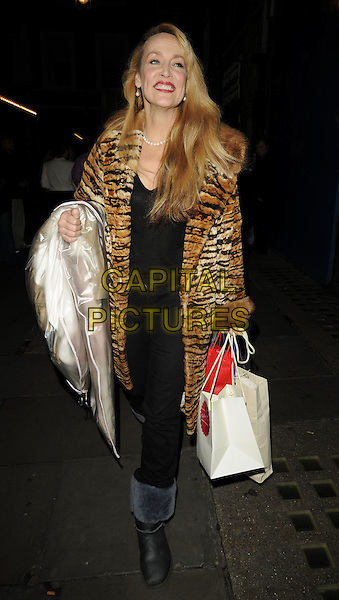 "JERRY HALL.Leaving the theatre after the current cast's last performance in ""Calendar Girls"", Noel Coward Theatre, London, England, UK, October 31st 2009..full length tiger animal brown back fur print coat ugg boots uggs bags dry cleaning bag trousers top .CAP/CAN.©Can Nguyen/Capital Pictures"