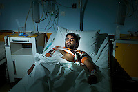 Greece/Athens/ Sep. 24.2012. L. Ali 22 years old from Pakistan, was attacked in a bus stop. He was on his way back home from his work, stepping out from the bus he was attacked and stabbed with a knife by two people. Racially motivated, brutal attacks and hate crimes have become an almost daily phenomenon in Greece that goes over its fifth year of recession..Giorgos Moutafis