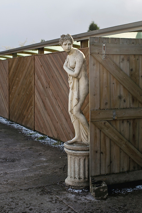 A mock statue of Canova's Venus Italica stands at the entrance of a garden centre in Stoke-on-Trent. Cheaper production costs have resulted in many of Staffordshire's famed pottery manufacturers relocating to the far east, leaving a scarred post-industrial landscape and high levels of unemployment in the region.