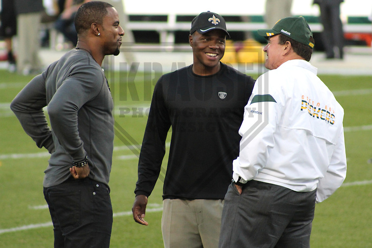 GREEN BAY - SEPTEMBER 2011: Darren Sharper (left) who played for both the Green Bay Packers and New Orleans Saints talks with Tony Oden (center) of the Saints and Dom Capers (right) of the Packers prior to a game on September 8, 2011 at Lambeau Field in Green Bay, Wisconsin. (Photo by Brad Krause) ...