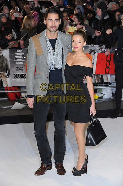 Hugo Taylor and Natalie Joel .The UK Premiere of 'Django Unchained', Empire Leicester Square, London, England..January 10th 2013.full length grey gray jacket black off the shoulder dress bag purse couple scarf.CAP/BEL.©Tom Belcher/Capital Pictures.