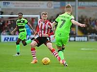Lincoln City's Michael O'Connor vies for possession with Forest Green Rovers' Carl Winchester<br /> <br /> Photographer Andrew Vaughan/CameraSport<br /> <br /> The EFL Sky Bet League Two - Lincoln City v Forest Green Rovers - Saturday 3rd November 2018 - Sincil Bank - Lincoln<br /> <br /> World Copyright © 2018 CameraSport. All rights reserved. 43 Linden Ave. Countesthorpe. Leicester. England. LE8 5PG - Tel: +44 (0) 116 277 4147 - admin@camerasport.com - www.camerasport.com